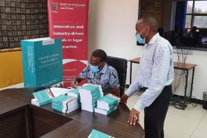 Book-Signing_Dr.-Kwinjera-and-Dr.-Mutunga-1-1